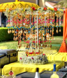 Tassels are so colourful and vibrant, incorporate them in as decor element in haldi or mehndi decor. Here we have some beautiful ideas to include tassel in the decor. Desi Wedding Decor, Indian Wedding Decorations, Diy Wedding, Indian Weddings, Wedding Ideas, Wedding Shoot, Hindu Weddings, Wedding Mehndi, Wedding Albums