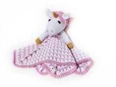 Ravelry: Unicorn Lovey pattern by Briana Olsen (I have this one)