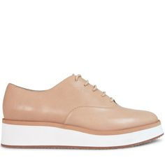Crafted from neutral nude leather, these platforms are some serious urban edge. Combining the support and white sole silhouette of a sneaker with the clean leather lace up upper of a brogue, Milas are a style stand out for any winter wardrobe.  Leather