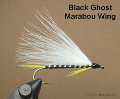 Black Ghost Marabou Wing   Hook: 6xl – 8xl streamer   Thread: Black   Tail: Yellow hackle fibers   Rib: Silver mylar tinsel   Body: Bla...