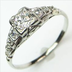 Fit and Flare: Precisely calibrated and graceful, this elegant Art Deco beauty traces a delicate line of sparkling diamond frosted steps across the finger, culminating in a nicely faceted and bright antique diamond. Ca.1930. Maloys.com