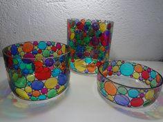 Potes que servem como luminárias, cachepôt, balde de gelo, enfim....  Tamanhos:  Grande 17cm de altura X 14cm de diâmetro  Médio 10cm de altura X 14 cm de diâmetro  Pequeno 7cm de altura X 14 cm de diâmetro  Preço: G=R$ 50,00 M= R$ 30,00 P= R$ 20,00  OBS: Reciclagem do vidro de palmito de 3 quilos  Pintura vitral feia a mão. R$ 100,00