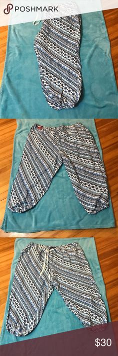 Multi Print Jogger Pants NWT multi-print jogger pants by Lane Bryant size 22/24. Beautiful pattern with white and different shades of blue. Lane Bryant Pants Capris