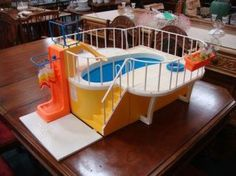 Vintage Barbie Dream House Swimming Pool.  I begged my mom for this year after year, but she always thought I'd spill water everywhere so I never got it, ended up using her Tupperware Bread Bin as a pool for my dolls instead