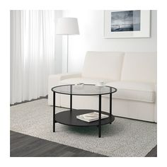 IKEA - VITTSJÖ, Coffee table, black-brown/glass, , The table top in tempered glass is stain resistant and easy to clean.You can select the expression you like best, since the shelf is black on one side and black-brown on the other.Stands evenly on uneven floors with the adjustable feet.