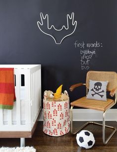 After: Toddler's Bedroom    A nursery that will grow with the child.      Chalkboard paint allows Tanya's son Eddie — once he's old enough — to draw on walls without rebuke. Painted iron moose antlers is a humorous art piece that doubles as hook storage.
