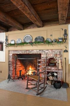 The homeowners salvaged vintage bricks and worked with a local mason to turn them into a colonial-style fireplace.   Photo: John Gruen