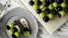 Recipe with video instructions: This fruity cake is a grape lover's dream come true. Ingredients: 1 bunch black grapes, 1 bunch green grapes, 1 castella sponge cake, honey, (grape mousse), 300ml grape juice, 60g granulated sugar, 200g plain yogurt, 200g heavy cream, 20g powdered gelatin