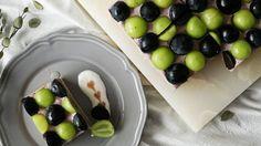 Recipe with video instructions: This fruity cake is a grape lover's dream come true. Ingredients: 1 bunch black grapes, 1 bunch green grapes, 1 castella sponge cake, honey, (grape mousse), 300ml grape juice, 60g granulated sugar, 200g plain yogurt, 200g heavy cream, 20g powdered gelatin