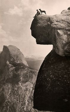 natgeofound:   A man and his dog on the Overhanging Rock in Yosemite National Park, May 1924.Photograph by Educational-Bruce Photograph