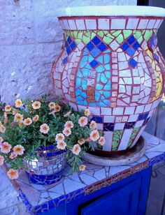 how to make a mosaic planter pot.  you can actually mosaic a coffee table, anything.  it's fun!