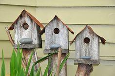 cute birdhouses..love the little rock steps