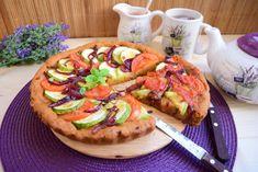 Reteta culinara Tarta cu dovlecel, rosii si ceapa caramelizata din categoria Mancaruri de post. Cum sa faci Tarta cu dovlecel, rosii si ceapa caramelizata