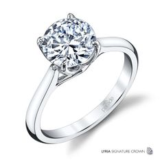 18K Parade Design Solitaire Engagement Ring Setting. Hold a round brilliant cut center diamond.