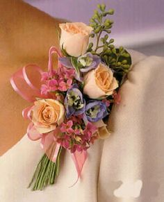 pin on corsage for mothers - I like the exposed stems, like tiny bouquets