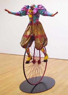 Lady on Unicycle, 2005  Life-size fiberglass mannequin, Dutch wax-printed cotton, steel