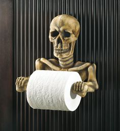 This bony fellow's grinning every time the paper's spinning. Spooky toilet paper holder is a most unexpected addition to your bathroom; a daring decorator's dream come true!