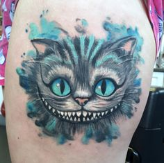 Healed photo of Tim burton Cheshire Cat tattoo. Tattoo Artist: Danie Carter