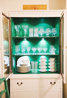 Meg Galligan Home Tour // bar cart // painted vintage furniture // kelly green and white // china cabinet // photography by Andi Hatch