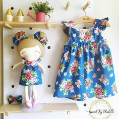 #Repost @gracedbycharlotte For Alice I absolutely adore this Strawberry Biscuit @elealutz designed Penny Rose fabric. This photo does not do it justice...the roses the teeny tiny strawberries it's just perfection. This is definitely one of those times I had a hard time parting with my creation. Suzie chose a dolly and me matching outfit for her daughter. I hope Alice loves this as much as I enjoyed making them #fabricswoon #strawberrybiscuit #elealutz #pennyrosefabrics #eleganceandelephants #boh Dolls And Daydreams, Bohemian Baby, Christening Gifts, Matching Outfits, Doll Clothes, Sewing Patterns, Girl Outfits, Daughter, Summer Dresses