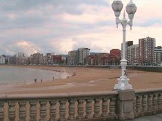 Spain!  This photo is from Gijon in Asturias, the province in which my dad was born.