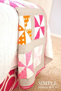 beautiful pinwheel quilt....this is a long way off in my sewing skills development... :)