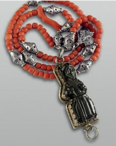 16th century rosary of coral with St. James pendant. Jet, carved; Silver, cast, gold-plated; Coral