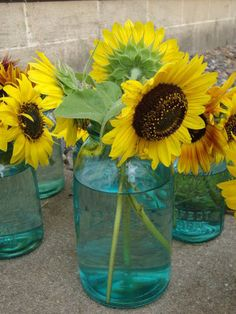 Sunflower Centerpieces in Mason Jars   Websites for homemade wedding centerpieces (tables)