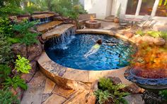 Stone Mason of Spring swimming pool and spa design and build. Custom design builder of pools, spas, waterfalls, landscapes