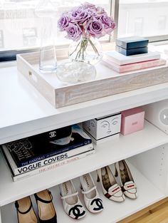 the girly display: shoes, coffee table books, pretty boxes and flowers