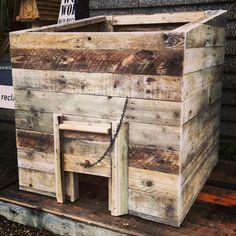 We're loving this reclaimed wood coal bunker.