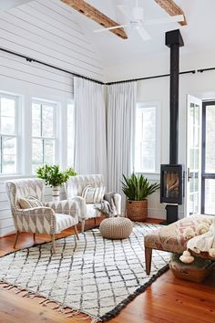 These Scandi-style rooms demonstrate how to master this cozy, minimalist look with style. #minimalist #scandinaviandecor #modernhomedecor #bhg Small Living Rooms, Living Room Decor, Living Room With Stove, Rustic Sunroom, Shiplap Paneling, Sunroom Decorating, Decorating Ideas, Sunroom Ideas, Decor Ideas