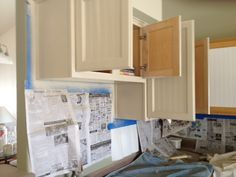 Weathered or Not: Kitchen Cabinet Makeover Tutorial - Using wall paper which resembles beadboard and cabinet paint .. looks fabulous the outcome .. like a brand new country shabby kitchen