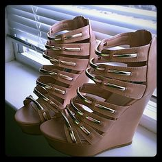 Wedge heels, with gold straps along front side Do not have original box. NEVER EVER WORN! Tan Wedge heels with gold straps lining the front of the shoe, awesome shoes! zipper closure in back! bamboo Shoes Heels