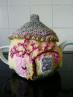 Handknitted lemon cottage tea cosy