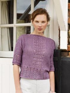 This beautiful lace and grid pattern sweater with grown on sleeves, is a must have for the season.
