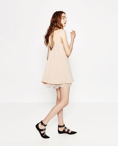 Dress with lace trim hem