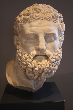 A Roman Marble Head of Herakles Epitrapezios Mid-2nd Century AD. From Nemi (Rome). Luna marble.