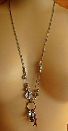 Thai Amulet, African Beads, Hill Tribe Silver with Sterling Silver and Aged Brass Chain Necklace, via Etsy.