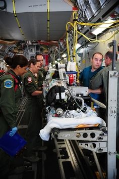 A specialized medical team ensures a patient is safe and ready for takeoff July 10, 2013, at Ramstein Air Base, Germany. A team of Brooke Army Medical Center doctors and nurses treated the patient with extracorporeal membrane oxygenation, or ECMO, during a nonstop C-17 Globemaster III flight from Germany to San Antonio. U.S. Air Force photo by Senior Airman Hailey Haux