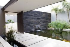 Architecture, Indoor Fish Pond Waterfall Bamboo Plants Stone Wall Cement Bridge Plus Iron Gate Door: The Outstanding House Sed Architected by Nico van der Meulen Architects