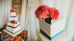 Spiral-Stacked Square Cake in Buttercream with Teal and Grey Ribbon Trim and Fresh Flowers. Images © Yuriy and Julia Manchik. www.themanchik...