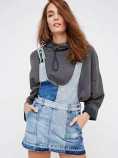Patchwork Blues One Piece Mini | Ultra cool denim one piece mini featuring a light and dark denim patchwork design with distressing and an undone hem for a lived-in look. Adjustable straps and side button closures for the perfect fit. Belt loops at the waist. Four pocket design.
