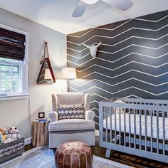 DIY FTW! Some painter's tape and a can of paint was all it took to create this fun modern chevron accent wall in the nursery. Design by @KristinMcCueInteriors