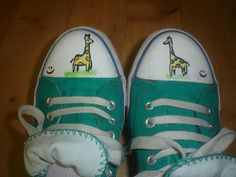 Totes drawing giraffes on my converse... pass me the sharpie!