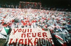 The pitch at Anfield, covered with thousands of bunches of flowers laid as a mark of respect to the many Liverpool fans who lost their lives at Hillsborough only a few days before. 17th April 1989.