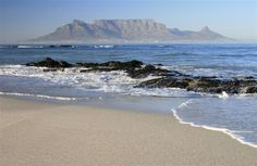 Walking on the beach in Blouberg Strand when it only had a couple of Cottages on the Beach.
