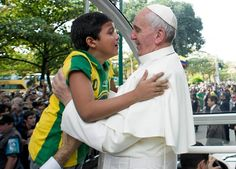 Pope Francis picks up a Brazilian boy, who breaks down crying as Francis holds him. pt.1