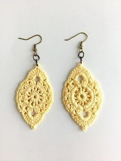 Throw on these cute crochet earrings for a casual day out on the town! These earrings are handmade by New Orleans local artist, Lady Valkryie. Measurements: 1.5' wide ; 2' long.