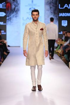 Off white sherwani by Raghavendra Rathore. Shop for your wedding trousseau, with a personal shopper & stylist in India - Bridelan, visit our website www.bridelan.com #Bridelan #Indiangroom